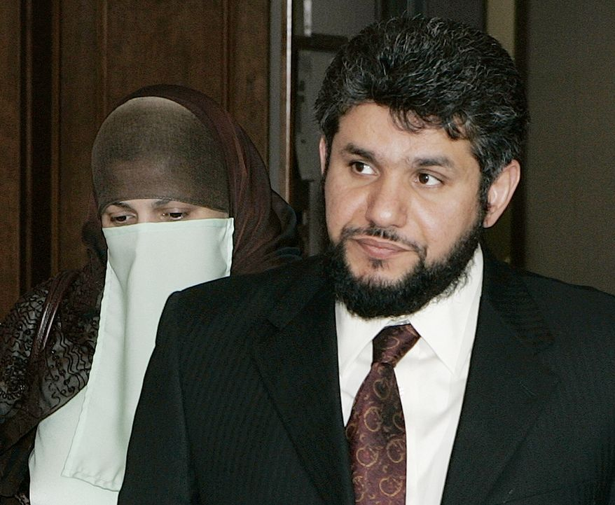 FILE -- This May 12, 2006 file photo shows Homaidan al-Turki, right, and his wife Sarah Khonaizan as they arrive for a hearing at the Arapahoe County courthouse in Centennial, Colo. Homaidan al-Turki, a Saudi national serving eight years in prison in Colorado on a sexual assault conviction, appeared at a hearing today Oct.24, 2013, to ask a judge to release him from prison and allow him to serve probation instead. He seeks to be deported to his home country to serve the rest of his sentence.(AP Photo/Ed Andrieski, File)