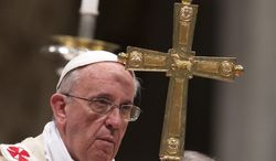 Pope Francis celebrates a ceremony to ordain two new bishops in St. Peter's Basilica at the Vatican on Thursday, Oct. 24, 2013. (AP Photo/Andrew Medichini)