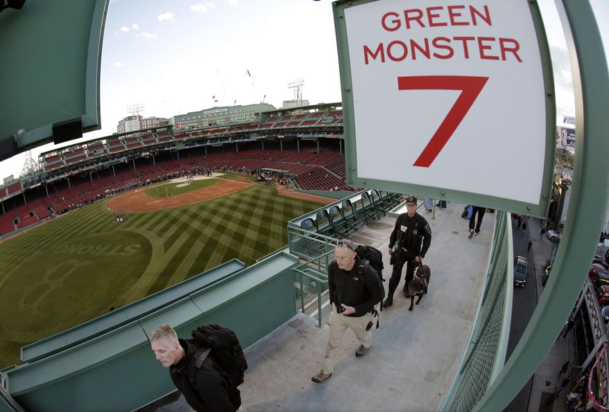 Security personnel make their way around Fenway Park before Game 2 of baseball's World Series between the Boston Red Sox and the St. Louis Cardinals Thursday, Oct. 24, 2013, in Boston. (AP Photo/Charlie Riedel)