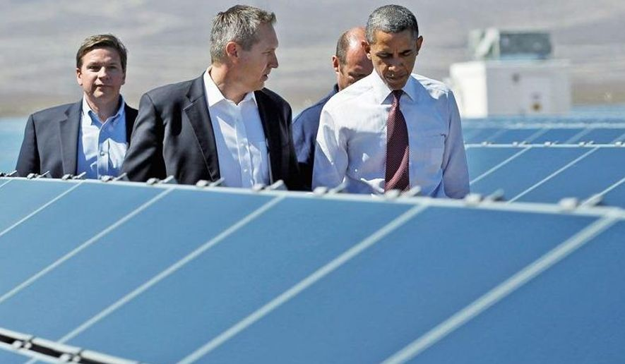 ** FILE ** In this April 4, 2012, file photo, President Obama listens to Jeffrey Martin, the chief executive officer of Sempra U.S. Gas Power, during a tour at the Copper Mountain Solar 1 facility in Boulder City, Nev. John Sowers and Kevin Gillespie also join the tour. (Associated Press)