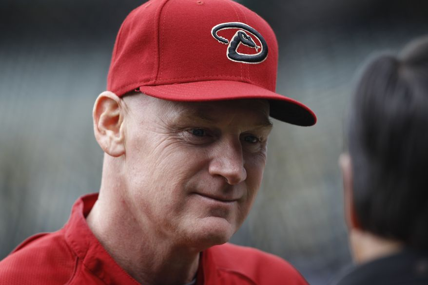 Arizona Diamondbacks third base coach Matt Williams chats with William Geivett, assistant general manager of the Colorado Rockies, before the first inning of a Major League Baseball game in Denver on Saturday, April 20, 2013. (AP Photo/David Zalubowski)