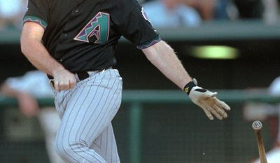 Arizona Diamondbacks Matt Williams connects for a single on a pitch from Colorado Rockies starting pitcher Darryl Kile to drive in two runs in the third inning Monday, June 1, 1998, in Denver's Coors Field. (AP Photo/David Zalubowski)