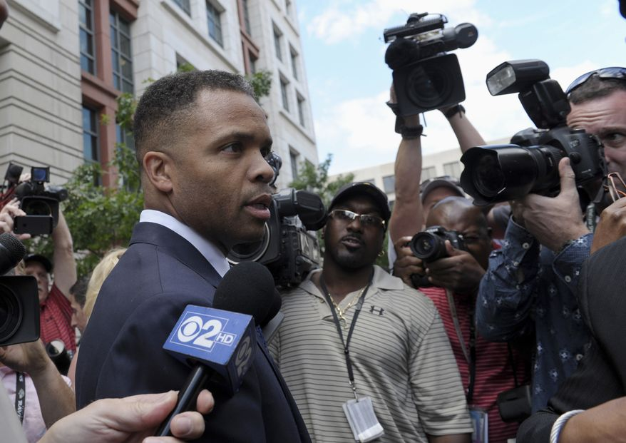 FILE - In this Wednesday, Aug. 14, 2013, file photo, former Illinois Rep. Jesse Jackson Jr., leaves federal court in Washington. Prison-bound Jackson plans to sell his home in Washington to help pay $750,000 in penalties stemming from his sentence for illegally spending campaign funds on personal items. (AP Photo/Susan Walsh, File)