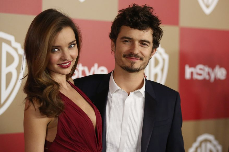 "FILE - In this Jan. 13, 2013 file photo, Miranda Kerr and Orlando Bloom arrive at the InStyle and Warner Bros. Golden Globe After Party at the Beverly Hilton Hotel in Beverly Hills, Calif. Bloom and Kerr confirmed the end of their marriage Friday, Oct. 25, 2013, saying they have been ""amicably separated for the past few months."" The couple, who were married in 2010, have a 2-year-old son, Flynn. (Photo by Matt Sayles/Invision/AP, File)"