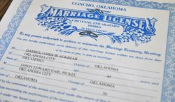 This Oct. 24, 2013 photo shows the marriage license issued to Darren Black Bear and Jason Pickel, by the Cheyenne and Arapaho Tribes, at Jason's home in Oklahoma City. Despite Oklahoma's ban on same-sex marriage, the couple will be legally married in the state thanks to Black Bear, who  is a member of the Oklahoma-based Cheyenne Arapaho Tribes. It's among the few Native American tribes in the U.S. that allow same-sex marriage.  (AP Photo/Nick Oxford)