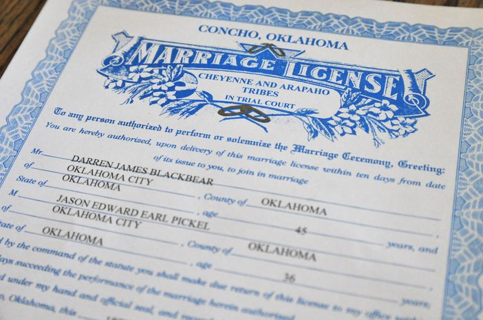 This Oct. 24, 2013 photo shows the marriage license issued to Darren Black Bear and Jason Pickel, by the Cheyenne and Arapaho Tribes, at Jason's home in Oklahoma City. Despite Oklahoma's ban on same-sex marriage, the couple will be legally married in the state thanks to Black Bear, who  is a member of the Oklahoma-based Cheyenne Arapaho Tribes. It