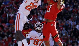 Clemson safety Jayron Kearse (20) intercepts a pass attempt to Maryland wide receiver Nigel King in the end zone in the first half of an NCAA college football game in College Park, Md., Saturday, Oct. 26, 2013. (AP Photo/Patrick Semansky)