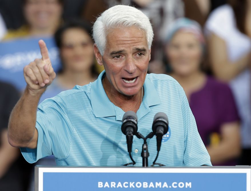 FILE - In this Thursday, Oct. 25, 2012 file photo, former Florida Gov. Charlie Crist gestures to supporters before a campaign speech by President Obama in Tampa, Fla. Three years after leaving the Florida governor's mansion and losing a U.S. Senate campaign, Charlie Crist is plotting a political comeback. The man who once identified himself as a Ronald Reagan Republican is gearing up for another gubernatorial bid as a Barack Obama Democrat. (AP Photo/Chris O'Meara, File)