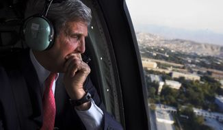 ** FILE ** In this Oct. 11, 2013, file photo U.S. Secretary of State John Kerry looks out the window en route to the ISAF headquarters after an unannounced visit to Kabul, Afghanistan. President Barack Obama and Kerry are trying to quell international anger over the latest classified disclosures about NSA tactics by Edward Snowden, who is still in Russia. (AP Photo/Jacquelyn Martin, Pool)