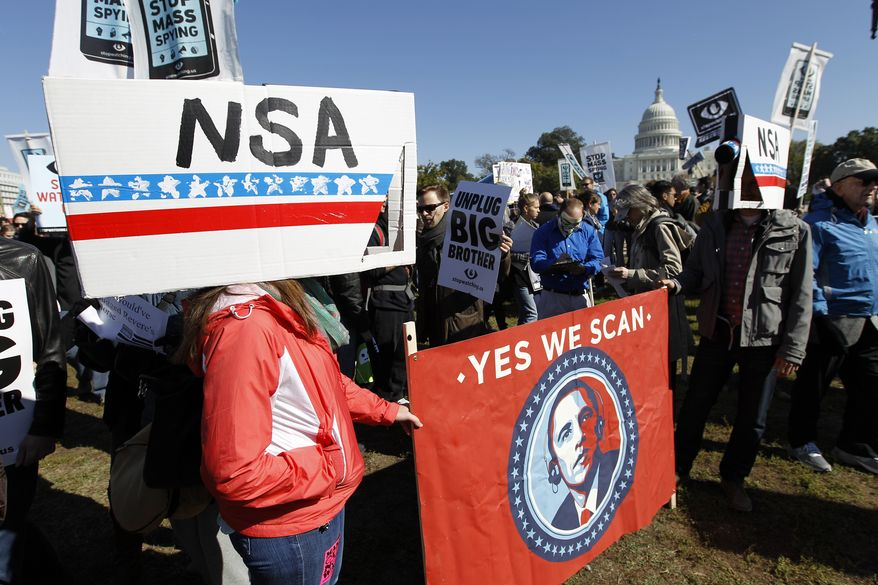 **FILE** Demonstrators protest outside of the U.S. Capitol in Washington during a rally to demand that the U.S. Congress investigate the National Security Agency's mass surveillance programs Saturday, Oct. 26, 2013. (AP Photo/Jose Luis Magana)