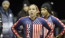 American bob team Jazmine Fenlator, right, and Lolo Jones look up after coming to a stop after racing in the United States women's bobsled team trials Friday, Oct. 25, 2013, in Park City, Utah. Fenlator and Jones came in third place. (AP Photo/Rick Bowmer)