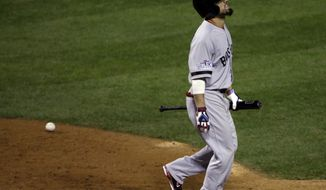 Boston Red Sox's Shane Victorino grimaces after being hit by a pitch during the eighth inning of Game 3 of baseball's World Series against the St. Louis Cardinals Saturday, Oct. 26, 2013, in St. Louis. (AP Photo/David J. Phillip)