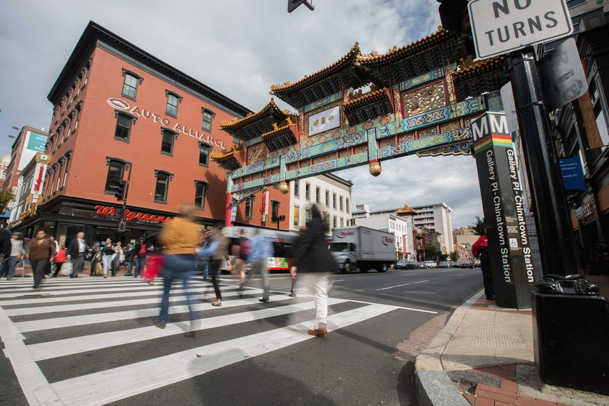 'Chinablock:' The Friendship Archway at Seventh and H streets Northwest was once a gateway to an economic and cultural safe zone for Chinese immigrants. Like in other Chinatowns across the nation, ancient culture is making way for modern business. (Andrew S. Geraci/The Washington Times)