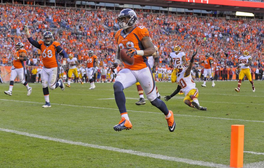Denver Broncos wide receiver Demaryius Thomas (88) crosses the goal line for a touchdown against the Washington Redskins in the fourth quarter of an NFL football game, Sunday, Oct. 27, 2013, in Denver. (AP Photo/Jack Dempsey)