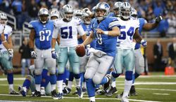 Detroit Lions quarterback Matthew Stafford (9) celebrates scoring on a 1-yard touchdown run against the Dallas Cowboys in the fourth quarter of an NFL football game in Detroit, Sunday, Oct. 27, 2013. (AP Photo/Rick Osentoski)