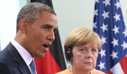 **FILE** President Obama speaks during a  press conference with German Chancellor Angela Merkel at the  Chancellery in Berlin on June 19, 2013. (Associated Press)