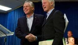 """Democratic gubernatorial candidate for Virginia Terry McAuliffe poses with former president Bill Clinton, right, during a campaign event, """"Putting Jobs First"""",  in Dale City, Va., Sunday, Oct. 27, 2013. (AP Photo/Molly Riley)"""