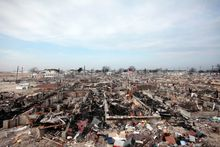 ** FILE ** This Dec. 4, 2012, file photo shows the ruins of Breezy Point in the Queens borough of New York where fire burned 130 houses and flooding destroyed another 220 during Superstorm Sandy. (AP Photo/Mark Lennihan, File)