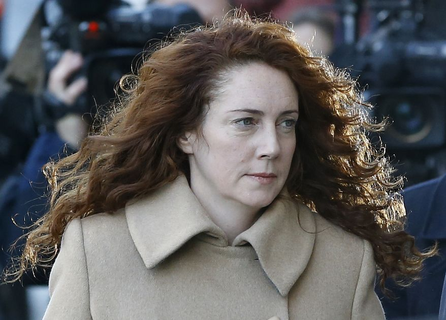 ** FILE ** Rebekah Brooks arrives at The Old Bailey law court in London, Monday, Oct. 28, 2013. Former News of the World national newspaper editors Rebekah Brooks and Andy Coulson are due to go on trial Monday, along with several others, on charges of hacking phones and bribing officials while at the now closed tabloid paper. (AP Photo/Kirsty Wigglesworth)