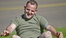 "In a Wednesday, Oct. 16, 2013 photo,  overweight service member who failed the so-called ""tape test"" struggles doing sit ups during a workout where he hopes to improve his conditioning and avoid being dismissed from the military, at the Marine Corps Recruit Depot in San Diego. Doctors say a number of military personnel are turning to liposuction to remove excess fat from around the waist so they can pass the Pentagon's body fat test. Some service members say they have no other choice because the Defense Department's method of estimating body fat is weeding out not just flabby physiques but bulkier, muscular builds. A number of fitness experts and doctors agree, and they're calling for the military's fitness standards to be revamped.  (AP Photo/Lenny Ignelzi)"