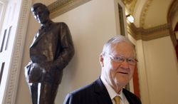 ** FILE ** In this Nov. 16, 2010, file photo, Rep. Ike Skelton, D-Mo. poses for a photograph in front of the Will Rogers Statue, on Capitol Hill in Washington. Skelton, who built a reputation as a military expert and social conservative during 34 years representing western and central Missouri in the U.S. House, died Monday, Oct. 28, 2013 in Virginia. He was 81. (AP Photo/Harry Hamburg, File)