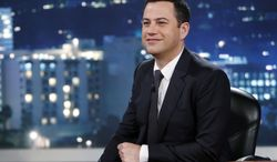 """This July 3, 2013 photo released by ABC shows Jimmy Kimmel on """"Jimmy Kimmel Live."""" ABC is apologizing for a segment of """"Jimmy Kimmel Live"""" in which a child joked about killing Chinese to help erase the U.S. debt. The boy's unscripted comment came during a comedy bit in which youngsters commented on news events. ABC's apology came in response to a complaint from a group called 80-20, which identifies itself as a pan Asian-American political organization. (AP Photo/ABC, Randy Holmes, File)"""