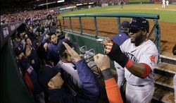 Boston Red Sox designated hitter David Ortiz (right) is congratulated by his teammates after scoring on a sacrifice fly by Stephen Drew during the fifth inning of Game 4 of baseball's World Series against the St. Louis Cardinals on Sunday, Oct. 27, 2013, in St. Louis. (AP Photo/Matt Slocum)