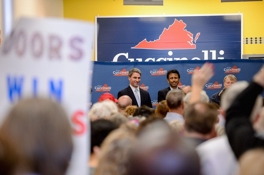 Louisiana Gov. Bobby Jindal (right) joins Kenneth T. Cuccinelli II, the Republican gubernatorial candidate, at a campaign rally at his Bristow campaign headquarters. (Andrew Harnik/The Washington Times)
