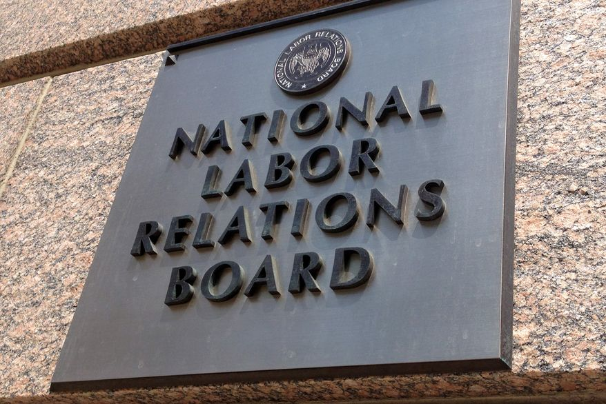 **FILE** The sign for the National Labor Relations Board is seen outside the organization's headquarters in downtown Washington on July 17, 2013. (Associated Press)
