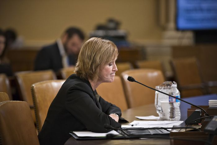 Marilyn Tavenner, administrator of the Centers for Medicare and Medicaid Services, pauses while testifying on Capitol Hill in Washington on Tuesday, Oct. 29, 2013, before the House Ways and Means Committee on the implementation of the Affordable Care Act. (AP Photo/J. Scott Applewhite)