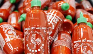 ** FILE ** Sriracha chili sauce bottles are produced at the Huy Fong Foods factory in Irwindale, Calif., in this Tuesday, Oct 29, 2013, file photo. (AP Photo/Nick Ut)