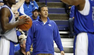 Kentucky head coach John Calipari watches his team during their Blue-White NCAA college basketball scrimmage, Tuesday, Oct. 29, 2013, in Lexington, Ky. The Blue team won 99-71. (AP Photo/James Crisp)
