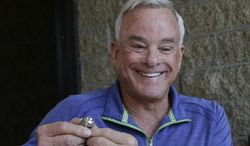 NFL Hall of Fame player Lance Alworth displays his 1971 Super Bowl ring that was stolen 21 years ago and returned by the San Diego County Sheriff office in Encinitas, Calif. Tuesday, Oct. 29, 2013, in Encinitas, Calif. Alworth, who starred as a San Diego Charger, won the Super Bowl ring while playing for the Dallas Cowboys.  (AP Photo/Lenny Ignelzi)