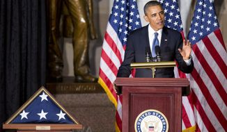 President Barack Obama speaks in Statuary Hall on Capitol Hill in Washington, Tuesday, Oct. 29, 2013, during a memorial service for the late former House Speaker Thomas S. Foley. Foley was a 30-year veteran of the House who died last week at the age of 84.   (AP Photo/Manuel Balce Ceneta)