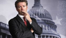 Sen. Rand Paul, Kentucky Republican, listens to a question during a news conference on Capitol Hill in Washington on Oct. 13, 2011. (AP Photo/Manuel Balce Ceneta)