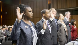 "Witnesses, from left, Sybrina Fulton, mother of Trayvon Martin; Ronald S. Sullivan, Jr., Clinical Professor of Law, Director of the Criminal Justice Institute, Harvard Law School; David LaBahn, Association of Prosecuting Attorneys president and CEO; Ilya Shapiro, Senior Fellow in Constitutional Studies at Cato Institute; John R. Lott, Jr., president, Crime Prevention Research Center of Swarthmore, Pa.; and Lucia McBath of Atlanta, Ga.; are sworn in on Capitol Hill in Washington, Tuesday, Oct. 29, 2013, prior to testifying before a Senate Judiciary subcommittee hearing on so-called ""stand your ground laws.""      (AP Photo/Manuel Balce Ceneta)"