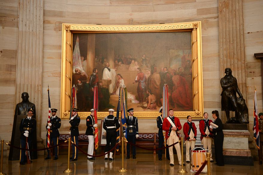 Members of the United States Armed Forces Color Guard wait for a dedication ceremony for a bust of former British Prime Minister Sir Winston Churchill to begin in Statuary Hall of the U.S. Capitol Building, Washington, D.C., Wednesday, October 30, 2013. The bust was authorized and passed by the House of Representatives shortly before the 70th anniversary of Churchill's wartime address to a joint meeting of Congress. (Andrew Harnik/The Washington Times)