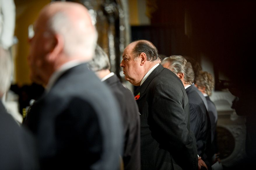 The Right Honorable Nicholas Soames, the grandson of Winston Churchill, center, stands during a dedication ceremony for a bust of former British Prime Minister Sir Winston Churchill, in Statuary Hall of the U.S. Capitol Building, Washington, D.C., Wednesday, October 30, 2013. The bust was authorized and passed by the House of Representatives shortly before the 70th anniversary of Churchill's wartime address to a joint meeting of Congress. (Andrew Harnik/The Washington Times)