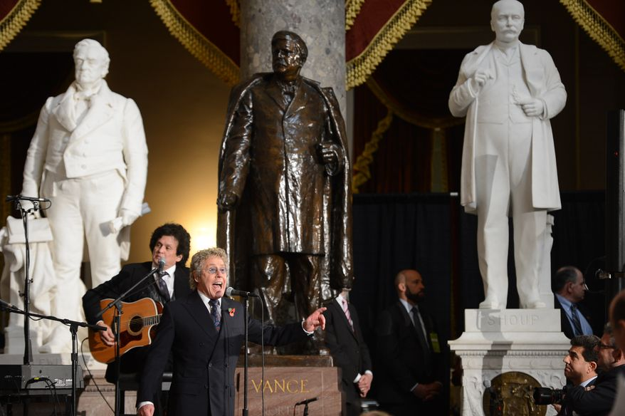 Roger Daltrey, lead singer of The Who, performs during a dedication ceremony for former British Prime Minister Sir Winston Churchill in Statuary Hall of the U.S. Capitol Building, Washington, D.C., Wednesday, October 30, 2013. The bust was authorized and passed by the House of Representatives shortly before the 70th anniversary of Churchill's wartime address to a joint meeting of Congress. (Andrew Harnik/The Washington Times)