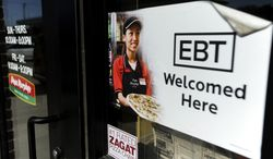 ** FILE ** In this Aug. 26, 2011, photo, a sign notifies customers that EBT (or Electronic Benefit Transfer) cards can be used at a store in Sioux Falls, S.D. (AP Photo/The Argus Leader, Jay Pickthorn)
