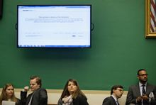 A screen shows the HealthCare.gov website being down during a House Energy and Commerce Committee hearing on Capitol Hill in Washington, Wednesday, Oct. 30, 2013, with Health and Human Services Secretary Kathleen Sebelius. (AP Photo/ Evan Vucci)