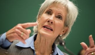 ** FILE ** Health and Human Services Secretary Kathleen Sebelius testifies on Capitol Hill in Washington, Wednesday, Oct. 30, 2013, before the House Energy and Commerce Committee hearing on the difficulties plaguing the implementation of the Affordable Care Act. (AP Photo/ Evan Vucci)