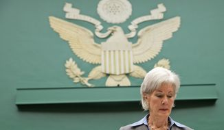 Health and Human Services Secretary Kathleen Sebelius pauses on Capitol Hill in Washington, Wednesday, Oct. 30, 2013, prior to testifying before the House Energy and Commerce Committee hearing on the difficulties plaguing the implementation of the Affordable Care Act. Sebelius, President Barack Obama's top health official faced tough questioning by a congressional committee Wednesday that will demand she explain how the administration stumbled so badly in its crippled online launch of the president's health care overhaul.  (AP Photo/ J. Scott Applewhite)