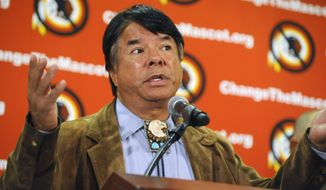 "Oneida Indian Nation representative Ray Halbritter speaks during a news conference, Wednesday, Oct. 30, 2013, in New York. Representatives of the Oneida have requested a meeting with all 32 NFL owners during Super Bowl week, hoping to persuade them to get the Washington franchise to drop the nickname Redskins. The Oneidas also asked for an amendment to league bylaws to prohibit franchises from naming a team with any term that is a racial epithet. Halbritter says the dictionary defines the word ""redskins"" precisely like that. (AP Photo/Louis Lanzano)"