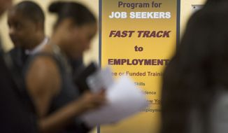 Job seekers line up to talk with recruiters during a job fair in Atlanta on Thursday, May 30, 2013.  (AP Photo/John Amis)