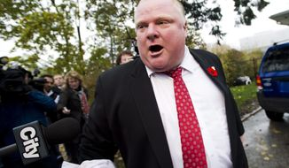 Toronto Mayor Rob Ford tells the media to get off his property as he leaves his home in Toronto on Thursday, Oct. 31, 2013. (AP Photo/Nathan Denette)