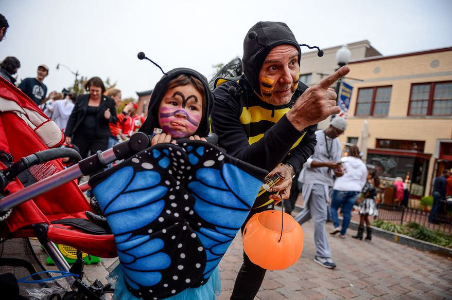 Nichola Yee, 3, and her grandfather George Psychas of Boston, Mass. dress up for a Halloween celebration at Eastern Market, Washington, D.C., Thursday, October 31, 2013. (Andrew Harnik/The Washington Times)