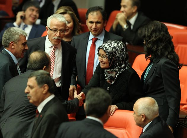 Gulay Samanci, surrounded by other lawmakers, is one of four female members of the ruling Justice and Development Party to wear headscarves to a session of the Grand National Assembly in Ankara, Turkey, on Thursday, Oct. 31, 2013, to mark the end o
