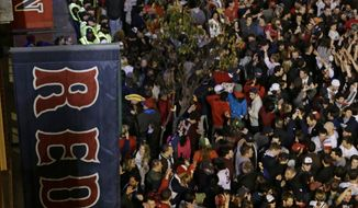 Boston Red Sox fans celebrate after Boston defeated the St. Louis Cardinals in Game 6 of baseball's World Series Wednesday, Oct. 30, 2013, in Boston. The Red Sox won 6-1 to win the series. (AP Photo/Charlie Riedel)