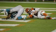 Miami Dolphins defensive end Cameron Wake (91) sacks Cincinnati Bengals quarterback Andy Dalton (14) in the end zone for a safety duringovertime of an NFL football game, Friday, Nov. 1, 2013, in Miami Gardens, Fla. The Dolphins defeated the Bengals 22-20 in overtime. (AP Photo/Wilfredo Lee)